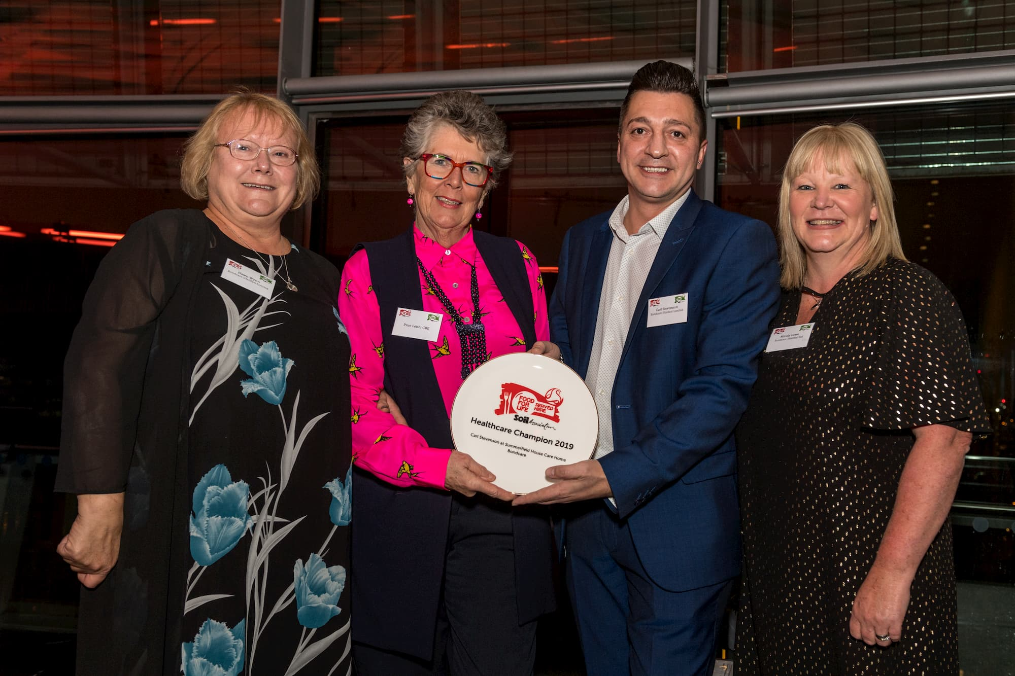 Summerfield House team receiving the award from Prue Leith